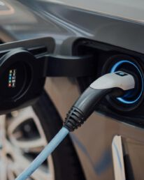An electric car plugged into a charging station.